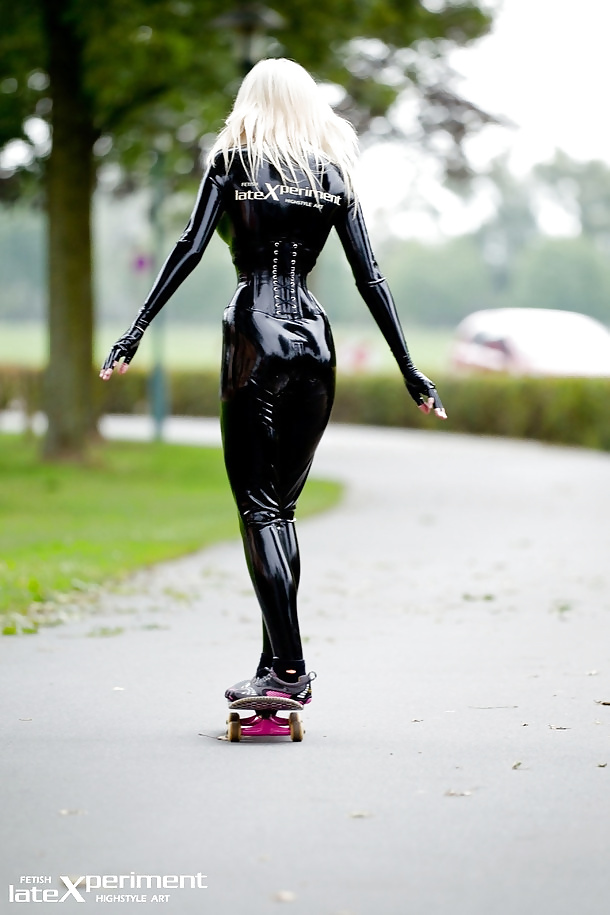 Blonde in Black Latex Skateboarding with Vibram Five Fingers